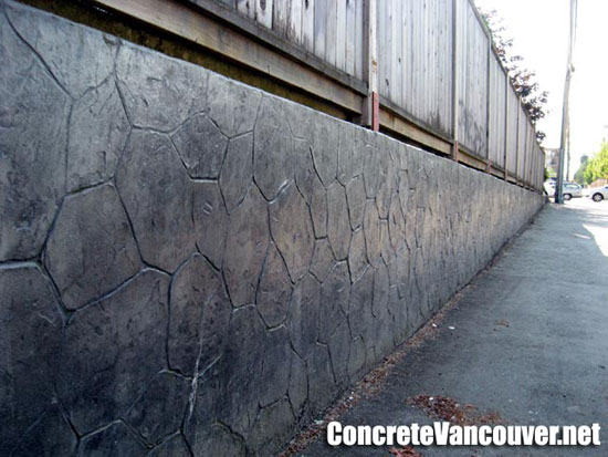 Stamped concrete retaining wall overlay